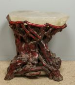 A Chinese fluorite mounted root wood stool The dished top above the naturalistic gnarled base.