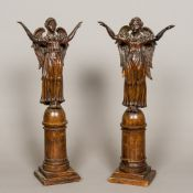 A pair of 18th/19th century Continental carved and stained softwood figures of angels Both worked