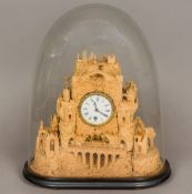 A Victorian carved cork mantel clock The white enamelled dial with Roman numerals and single