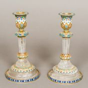 A pair of enamel decorated silver and rock crystal candlesticks Each with removable drip-pan above