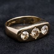 A 18 ct gold diamond three stone ring Gypsy set, the central stone spreading to approximately 0.