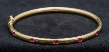 A Thurlow and Champness ruby set 18 ct g