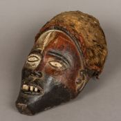 An African carved wooden tribal mask