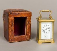 A 19th century miniature brass cased carriage alarm clock Of typical form,