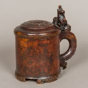 An 18th century Scandinavian treen burr birchwood peg tankard The domed lion carved lid with a