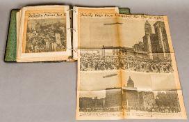 A scrapbook containing newspaper cutting
