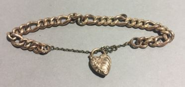 A 9 ct gold bracelet with heart padlock (14.