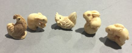 Five small bone carved animals