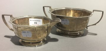 A silver cream jug and sugar bowl,