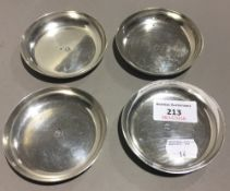 A set of four silver dishes (291.