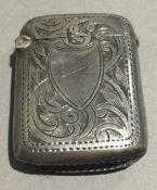 A small silver vesta case