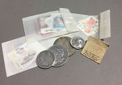 A small quantity of silver coins and stamps