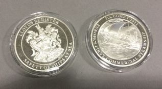 Two silver proof coins