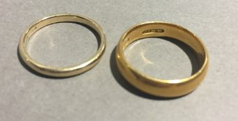 A 22 ct gold wedding band (5.9 grammes) and a 9 ct gold wedding band (1.