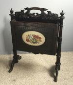 A Victorian carved oak magazine rack,