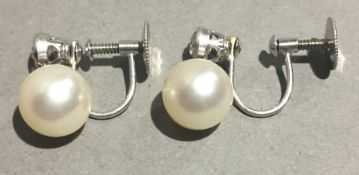 A pair of 18 ct white gold diamond and pearl earrings