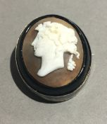 A silver mounted cameo brooch