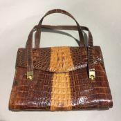 A crocodile skin handbag