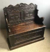 A Victorian carved oak settle