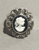 A silver cameo and marcasite ring