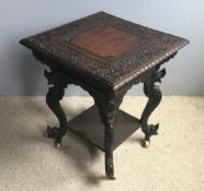 An Eastern carved side table
