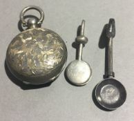 A silver sovereign holder and two napkin holders