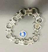 A Victorian silver bracelet with enamel and silver 1936 Coronation charm