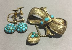 A turquoise set bow brooch and a pair of earrings