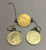 A French gold coin set as a brooch and a pair of coin formed earrings