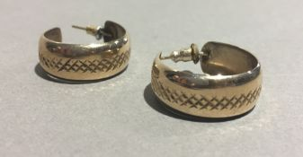 A pair of 9 ct gold hoop earrings (4 grammes total weight)