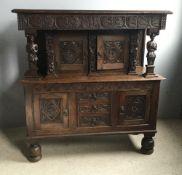 A carved oak court cupboard