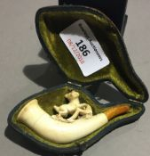 A cased Meerschaum pipe worked with a dog