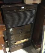 An early 20th century tambour fronted filing cabinet