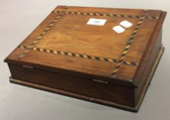 A parquetry inlaid writing slope