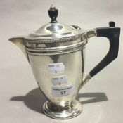 A silver hot water jug,