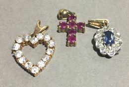 Three 9 ct gold pendants, diamonds,