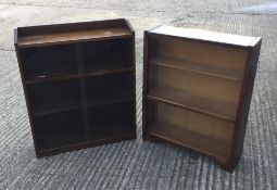 An oak glazed bookcase and another