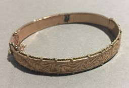 A 9 ct gold bangle form bracelet (13 grammes total weight)