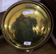 A brass bed warming pan with riggle work decoration