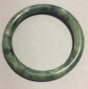 A spinach jade bangle