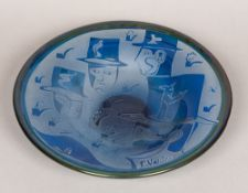 A Kosta Boda blue Art glass bowl, decorated with various stylised heads wearing top hats,