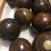 A set of nine turned treen carpet bowls