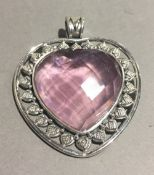 A silver and pink heart dress pendant