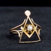 An unmarked gold diamond set ring, worked with Masonic emblems. 2.2 cm high.