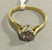 An 18 ct gold diamond set ring (2 grammes total weight)