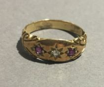 An 18 ct gold diamond and ruby ring (2.