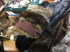 A collection of fur coats and stoles, etc.