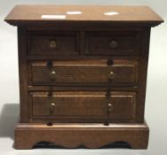 A miniature oak chest of drawers