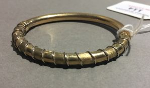 A 9 ct gold Italian hinged bangle (12 grammes total weight)