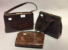 Three vintage crocodile handbags